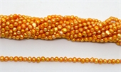 Fresh Water Pearl potato side drill 5.8x5mm Orange strand 87 beads-5 strands or more for $4.00 per strand-Beadthemup
